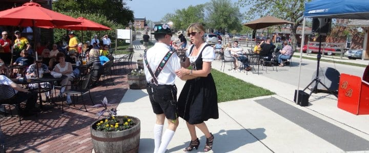 Man and lady in period dress dancing at festival