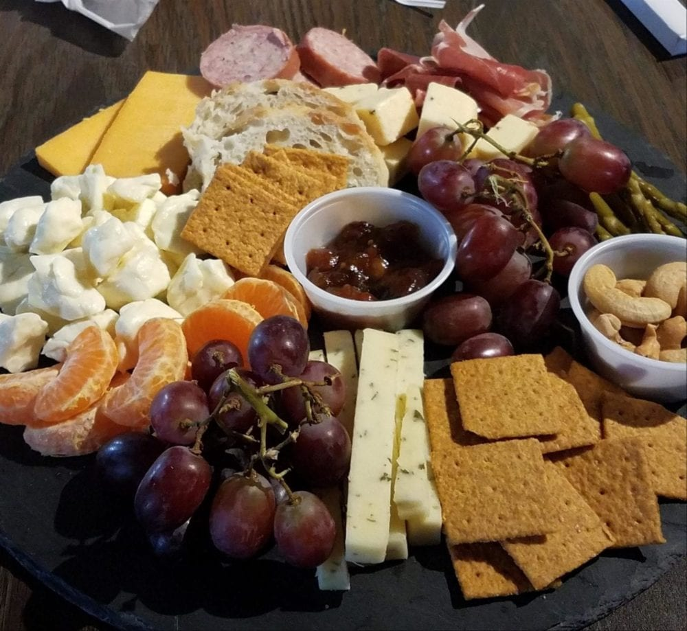 Tray of cheese, fruit, crackers, nuts