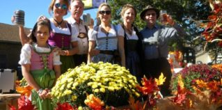 People in costume celebrating Oktoberfest