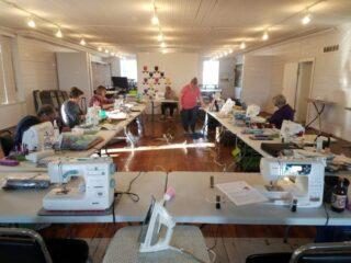 ladies sewing in large room