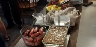 Buffet of casseroles and foods on table