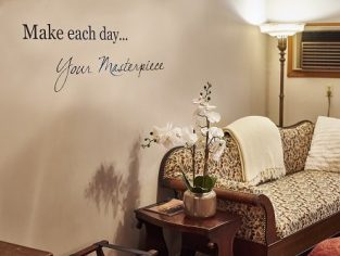 Make each day... Your Masterpiece on wall over sofa