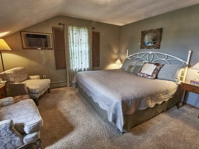 Room 8 with king-sized bed and comfy chairs for relaxing