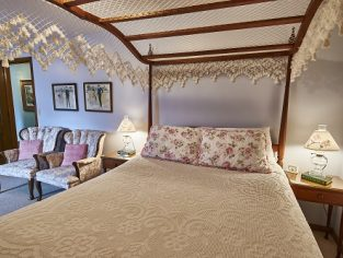 Room 10 with queen size bed and pink accents