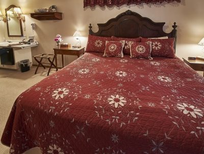 Room 11 with king size bed and red accents