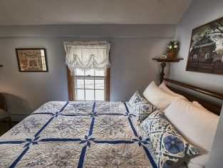 Room 14 with queen size bed and blue accents