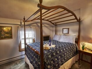 Room 15 with full size bed and blue accents