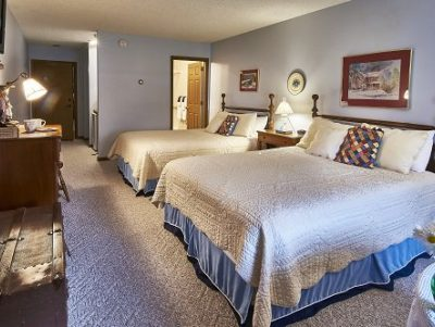 Room 16 with 2 queen size beds with blue accents